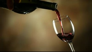 stock-footage-pouring-red-wine-into-glass
